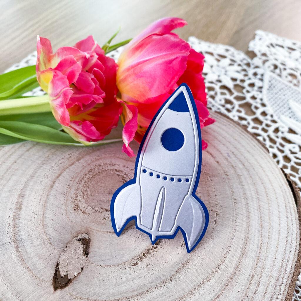 Podziękowania dla gości - motyw rakiety kosmicznej.