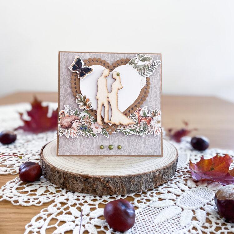 Ręcznie wykonana kartka ślubna w jesiennych kolorach i z leśnymi dekoracjami.